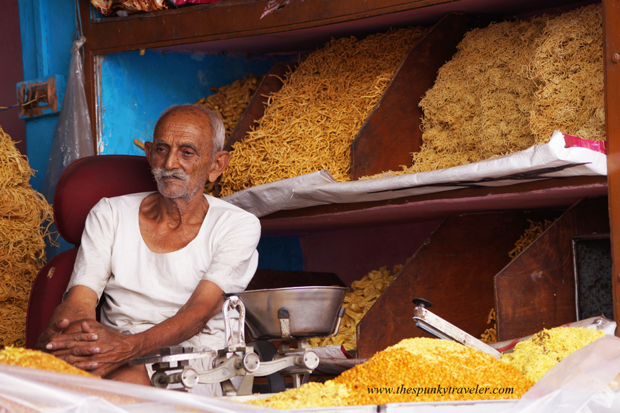 Traditional businessmen in the bylanes of Pushkar city